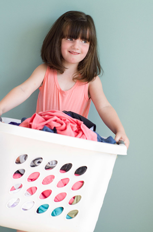 girl with laundry basket