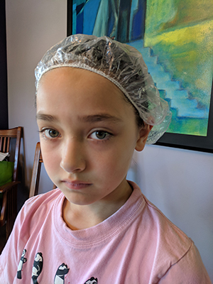 The author's daughter as she undergoes treatment for lice