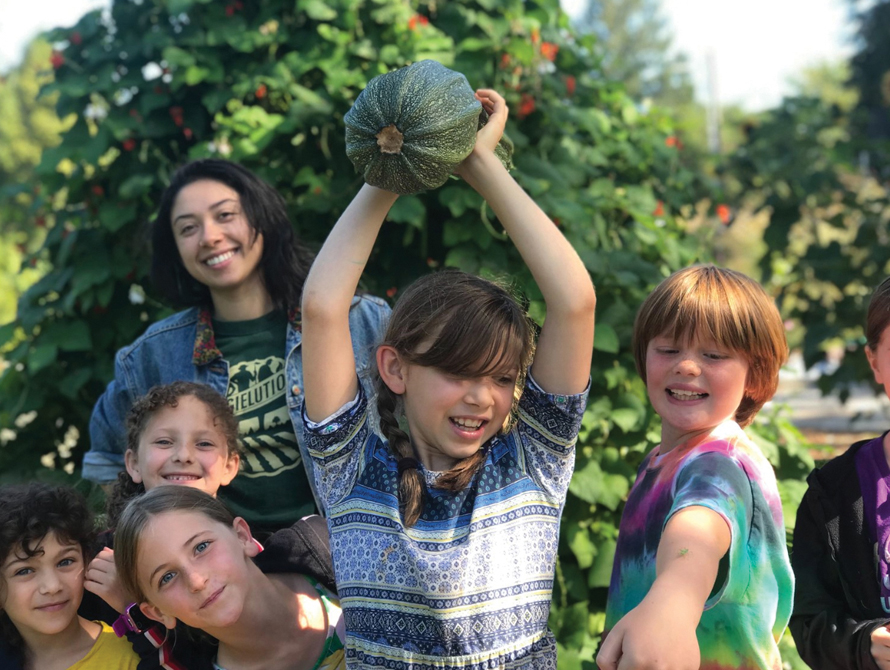 seattle cucina kids outside with squash