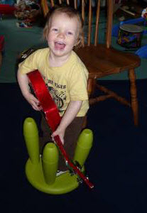 Toddler playing ukulele