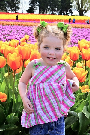 girl in front of tulip field