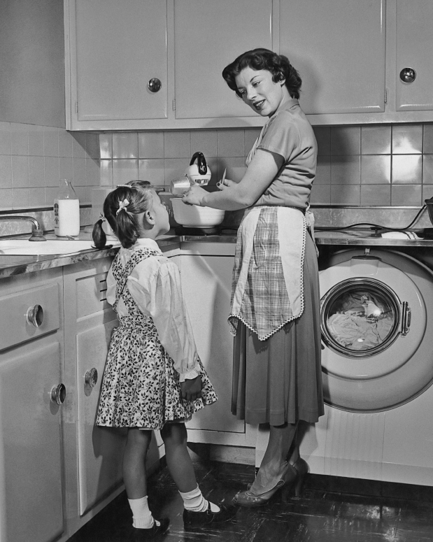 Vintage photo of a mother and child in a kitchen
