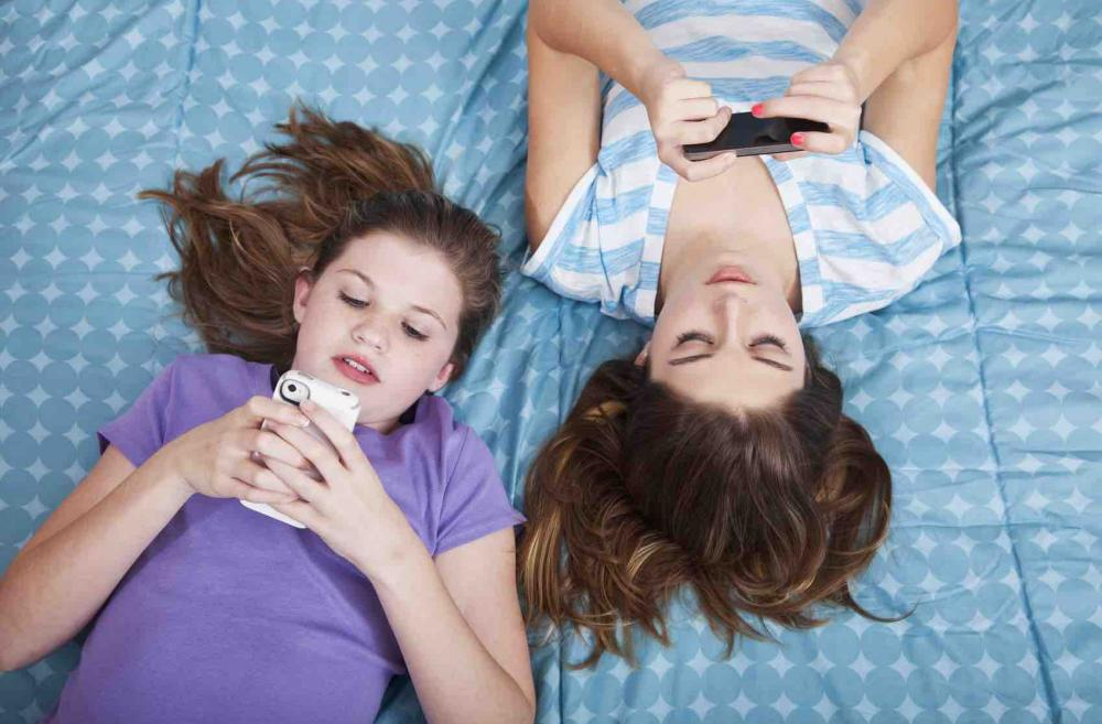 Two girls texting