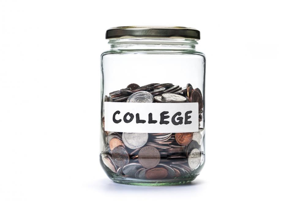 College savings jar of coins