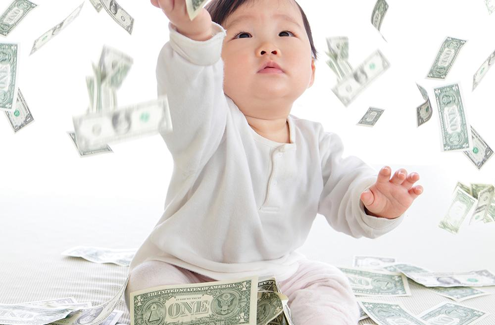 Baby playing with dollars