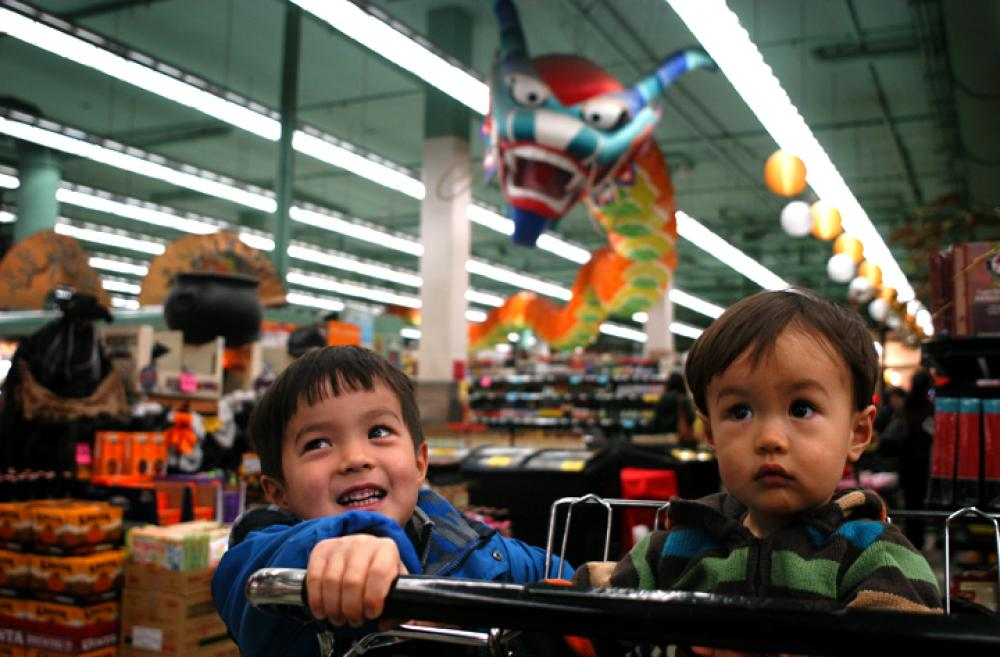 Two children in a supermarket in Seattle's International District