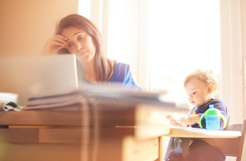 Young mother with computer and child