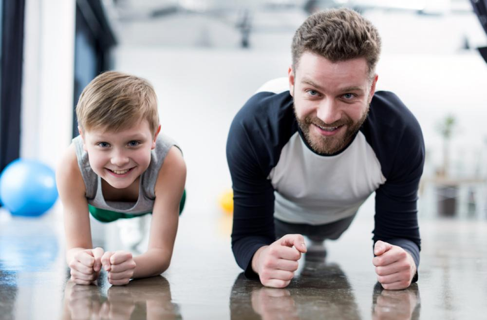 Dad and child exercising