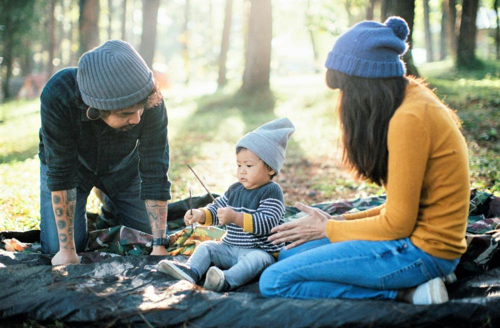 Family setting up camp with a baby