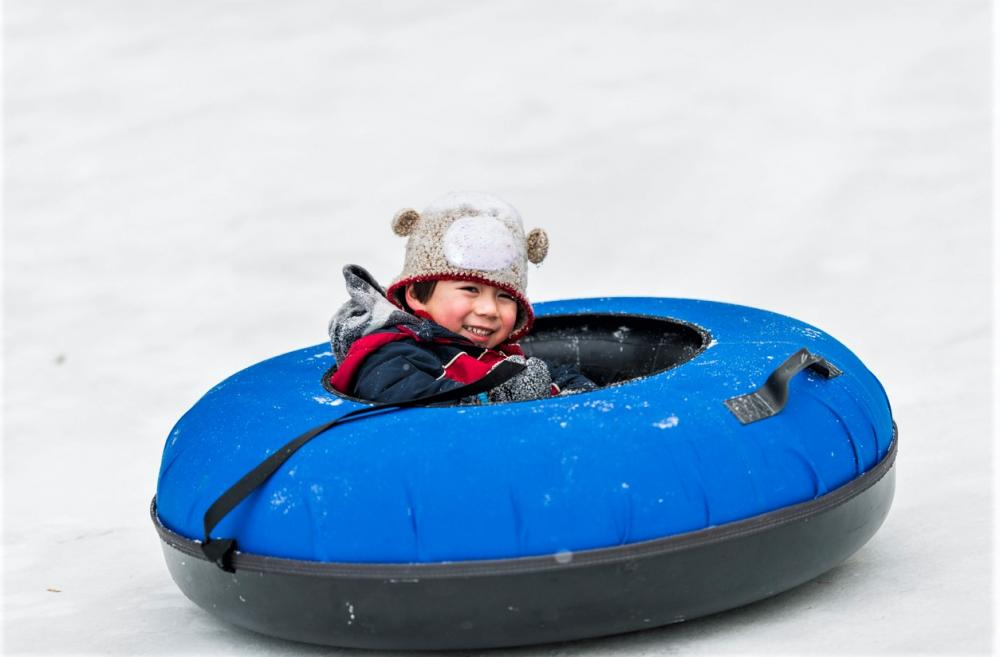 Boy-tubing-in-the-snow-best-places-for-sledding-and-tubing-around-Seattle