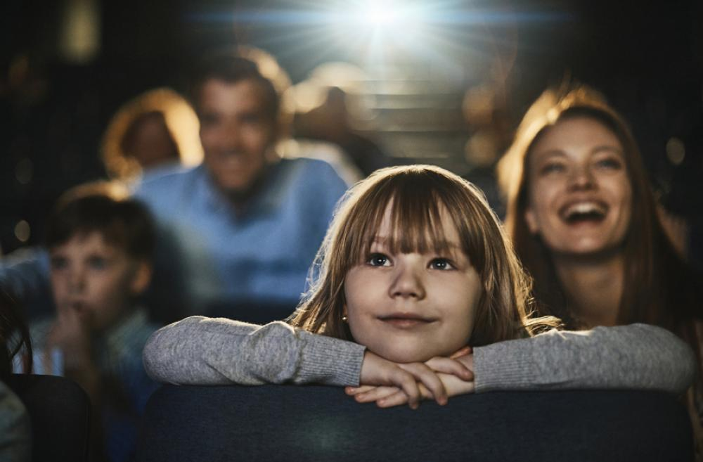 kid watching a movie