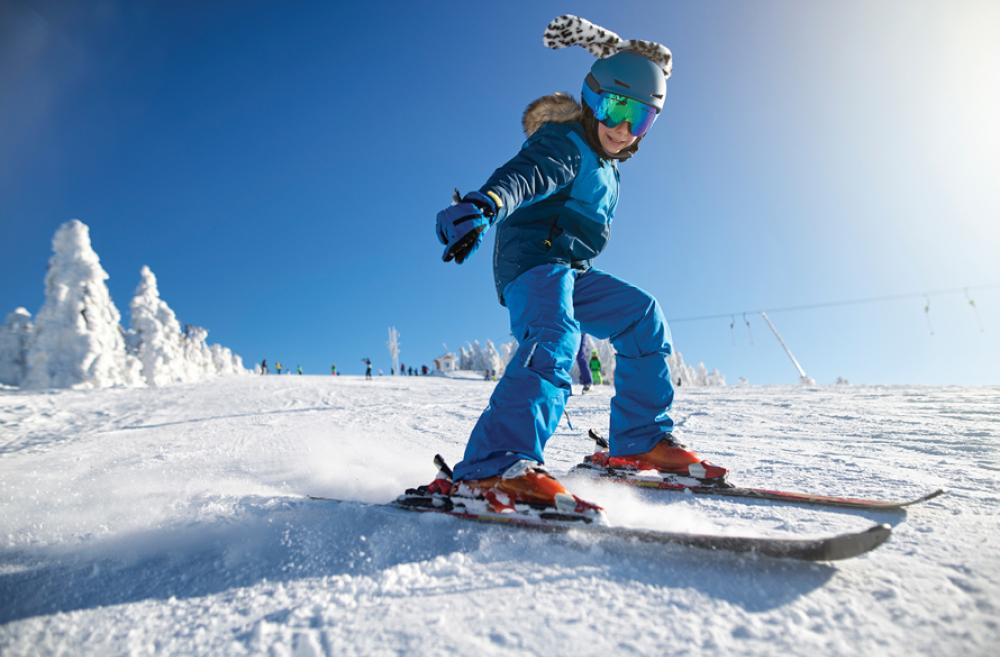 girl skiing on a sunny day