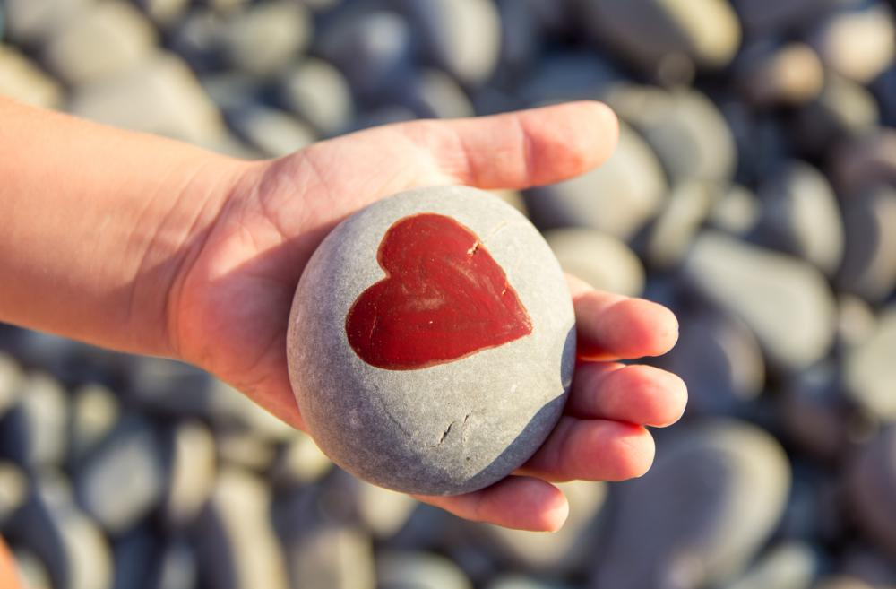 Child-hand-heart-on-rock-painted-rock-treasure-hunt-free-outdoor-crafty-fun-kid-families