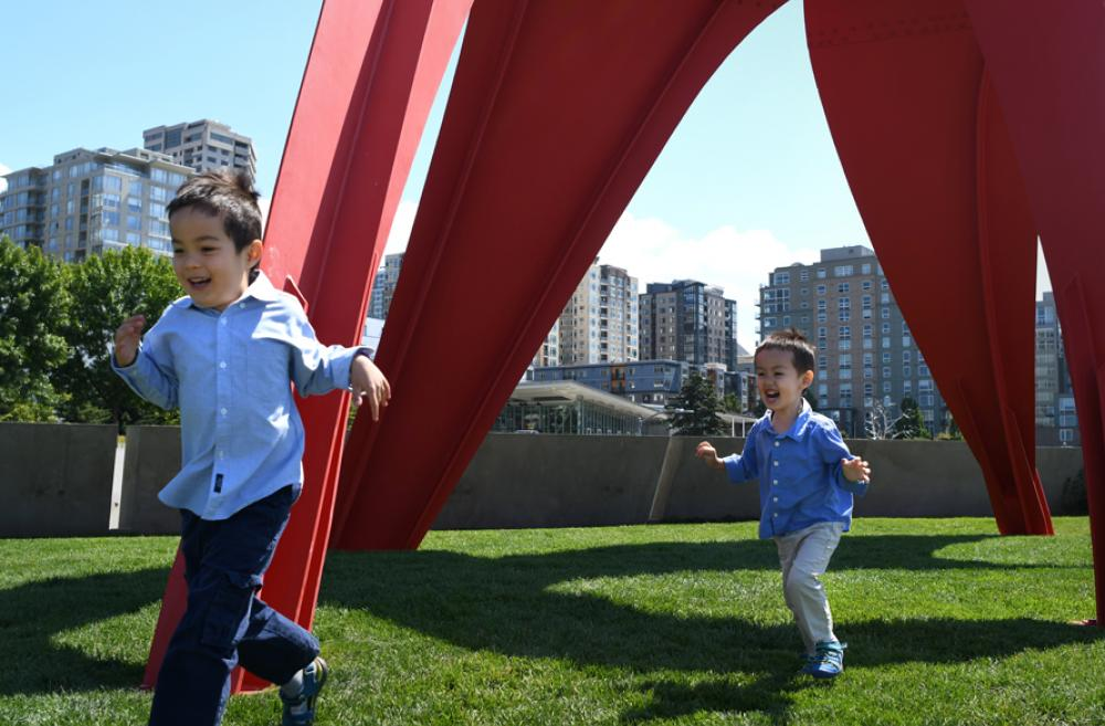 little boys running through the sculpture park by the Seattle waterfront