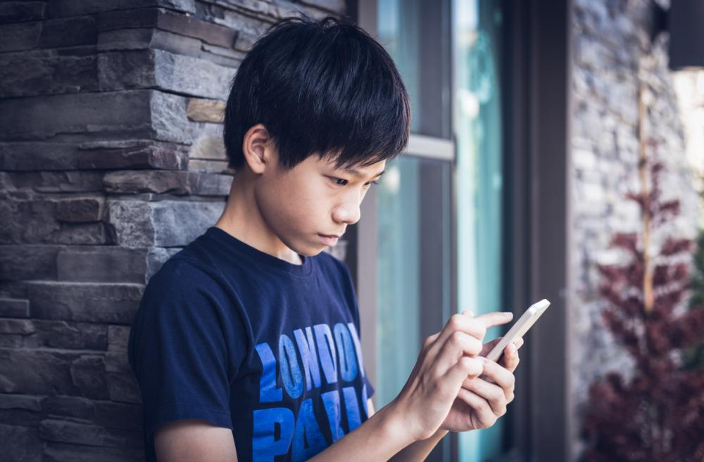 Asian teenager using smartphone