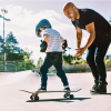 Boy learning to skateboard at skate park