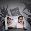 kids in bed with shadow monsters