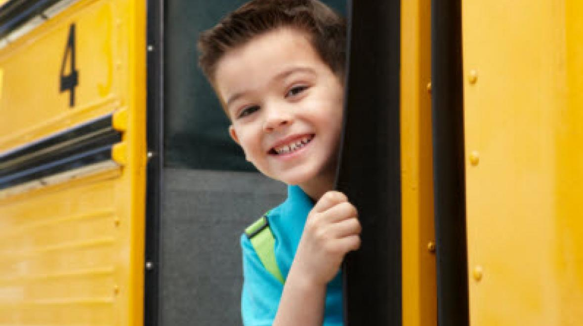 Boy smiling on school bus