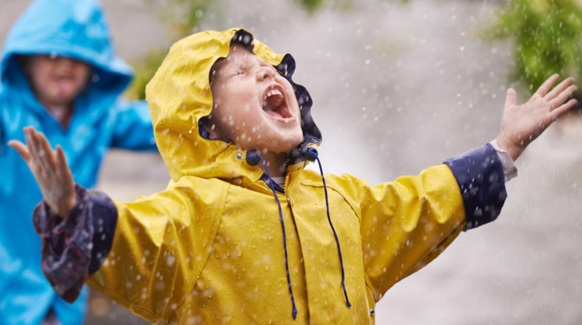 Boy shouting into the rain