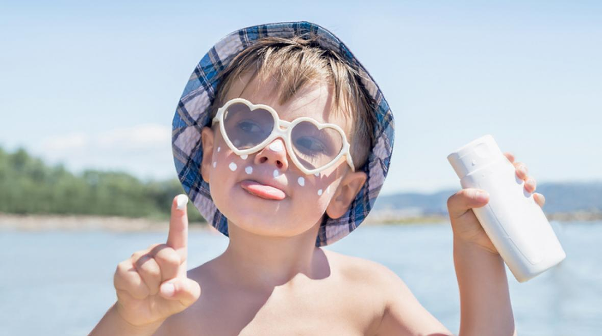 Kid with sunscreen