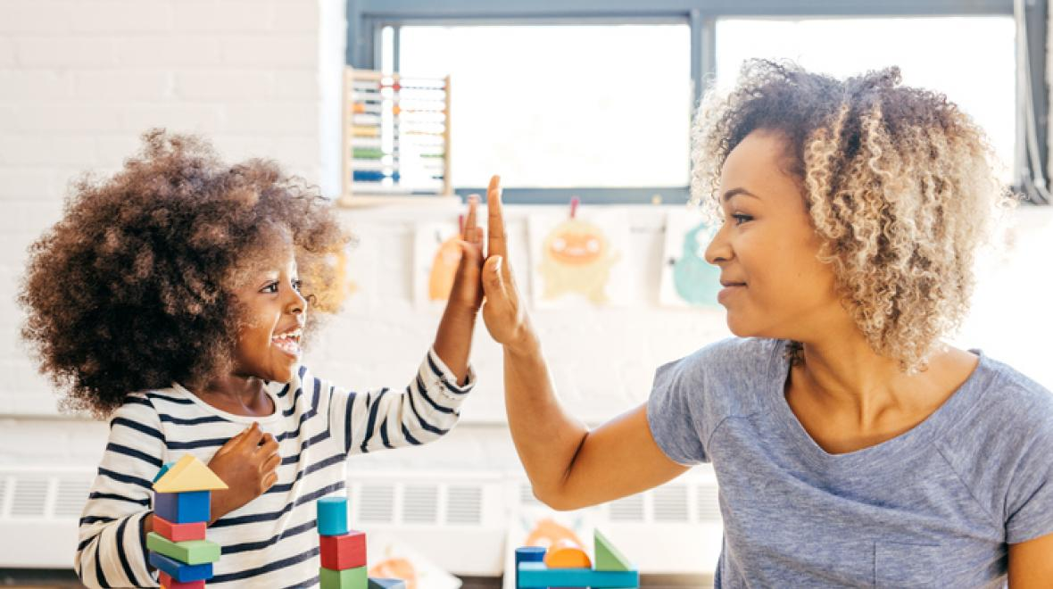 Mom and daughter high-fiving