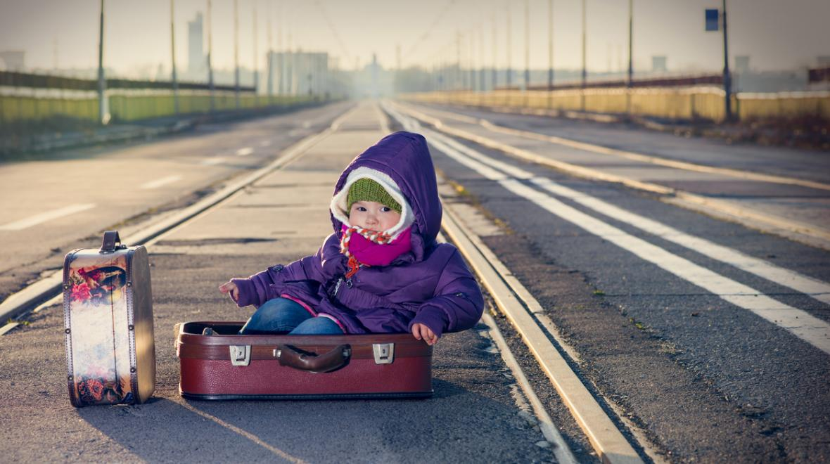 baby-in-suitcase-by-railroad