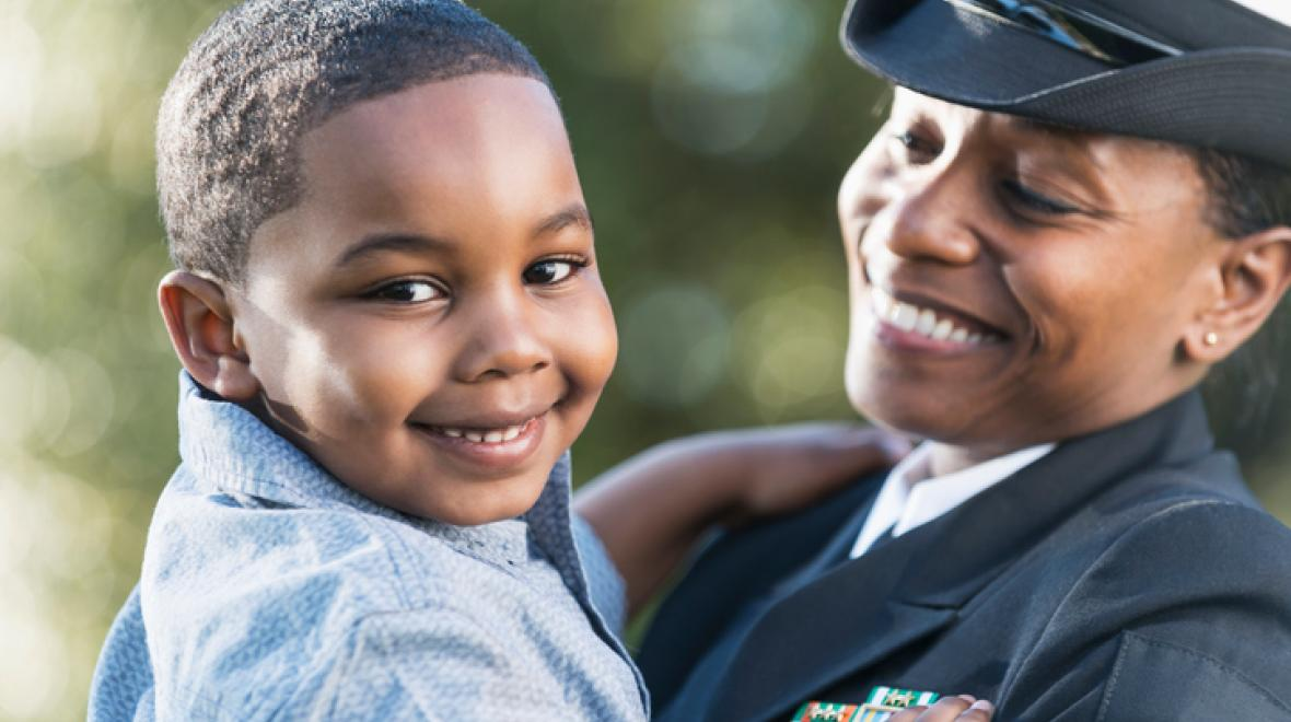 Kid with mom in Navy uniform