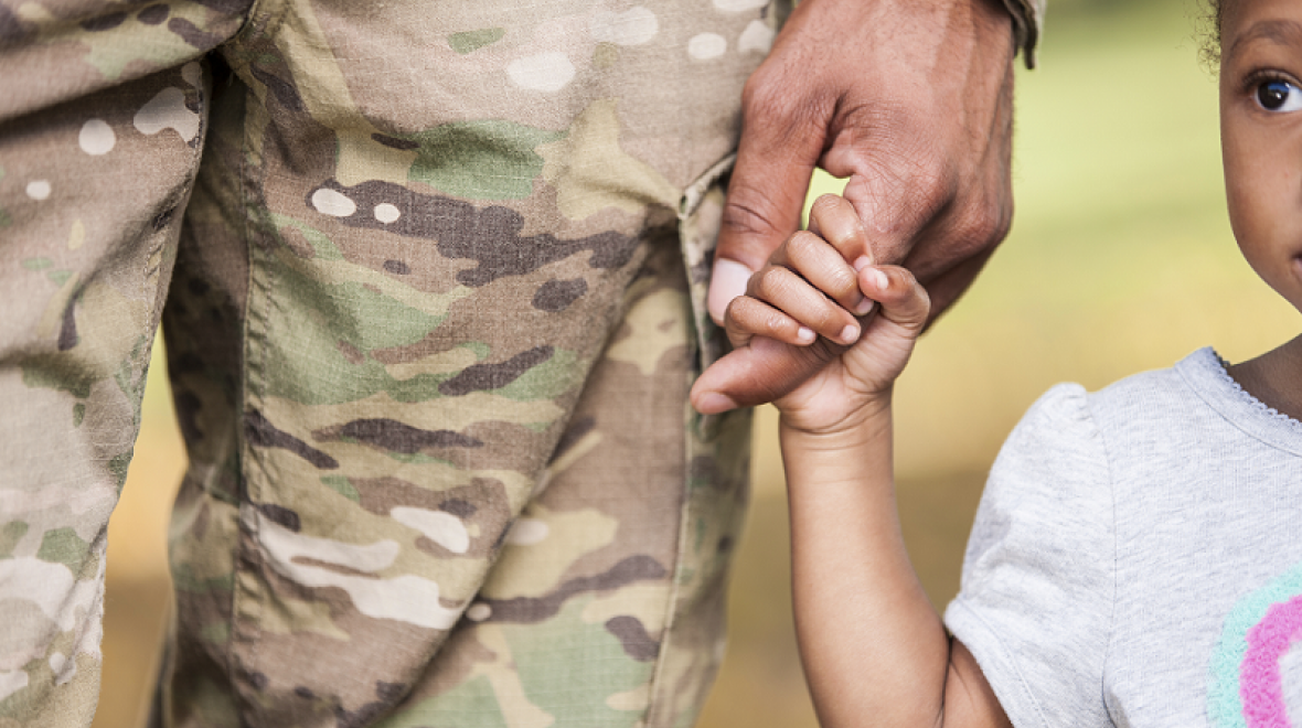 Military-dad-holding-daughters-hand