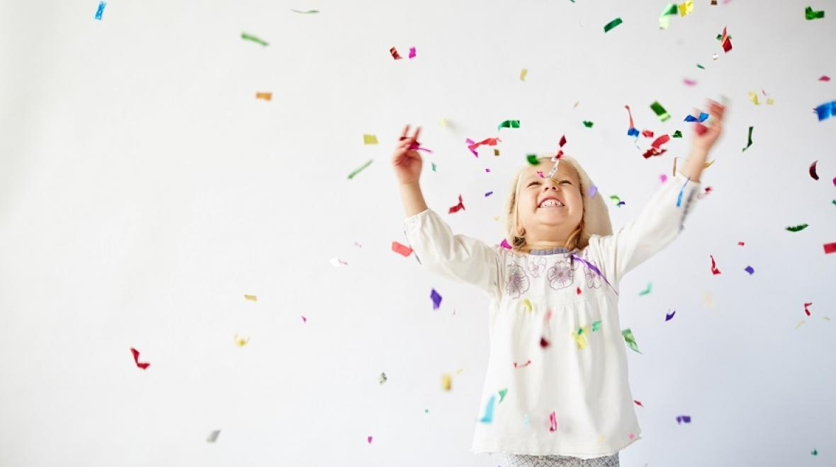 Girl throwing confetti