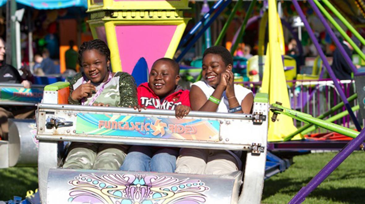 kids on a ride at the fair