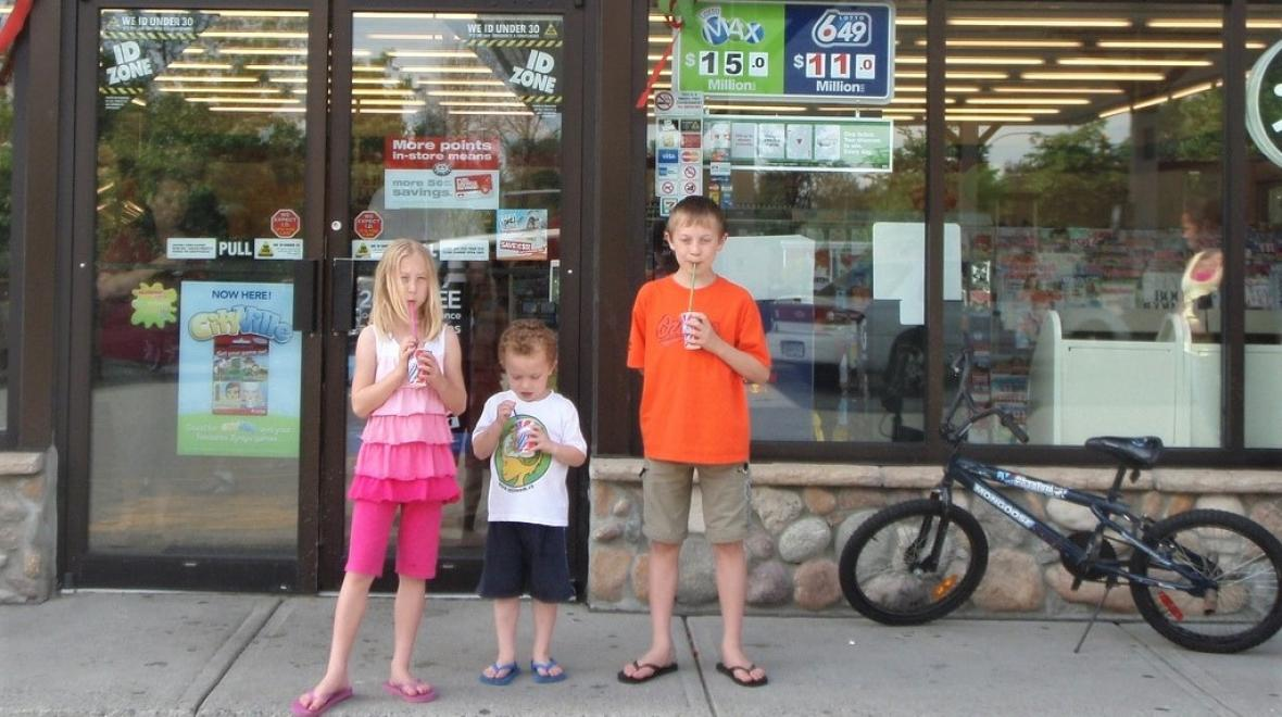 Kids drinking free Slurpees from 7-11