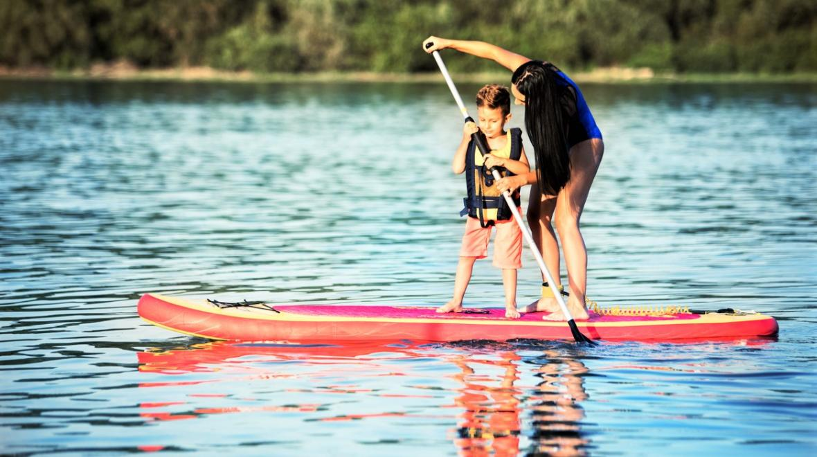 Mom and child stand-up paddleboarding