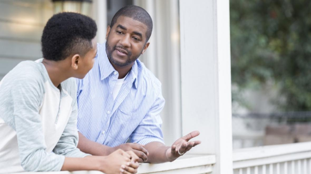 Father having serious talk with teenage son