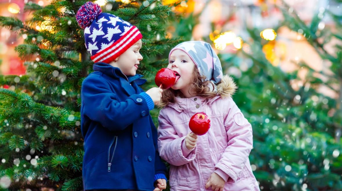 Holiday outings on a budget for families kids with candied apples