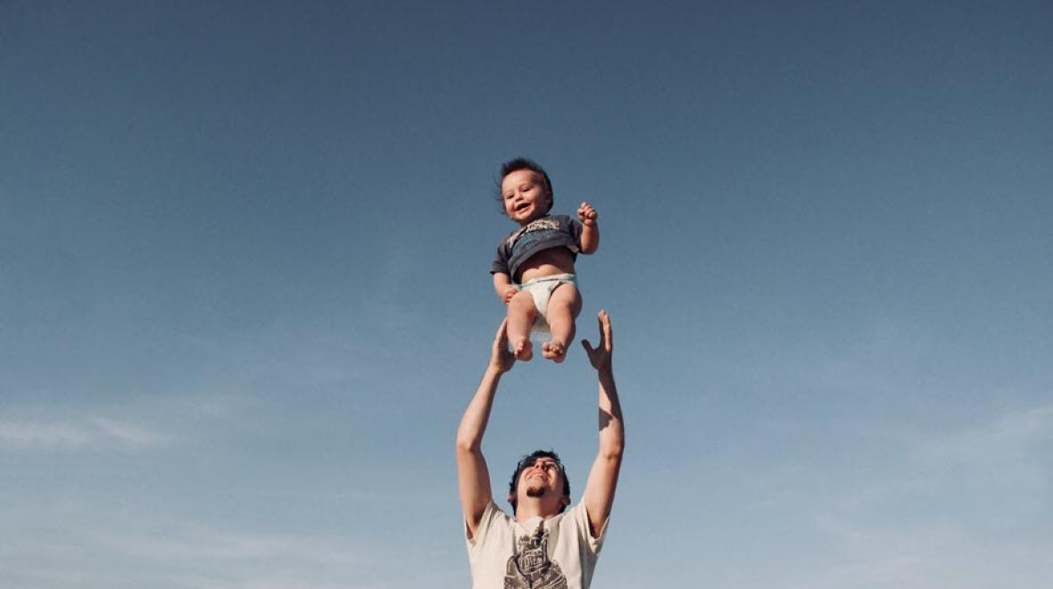 Father tossing his son into the air