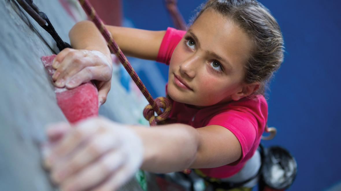 girl rock climbing camp