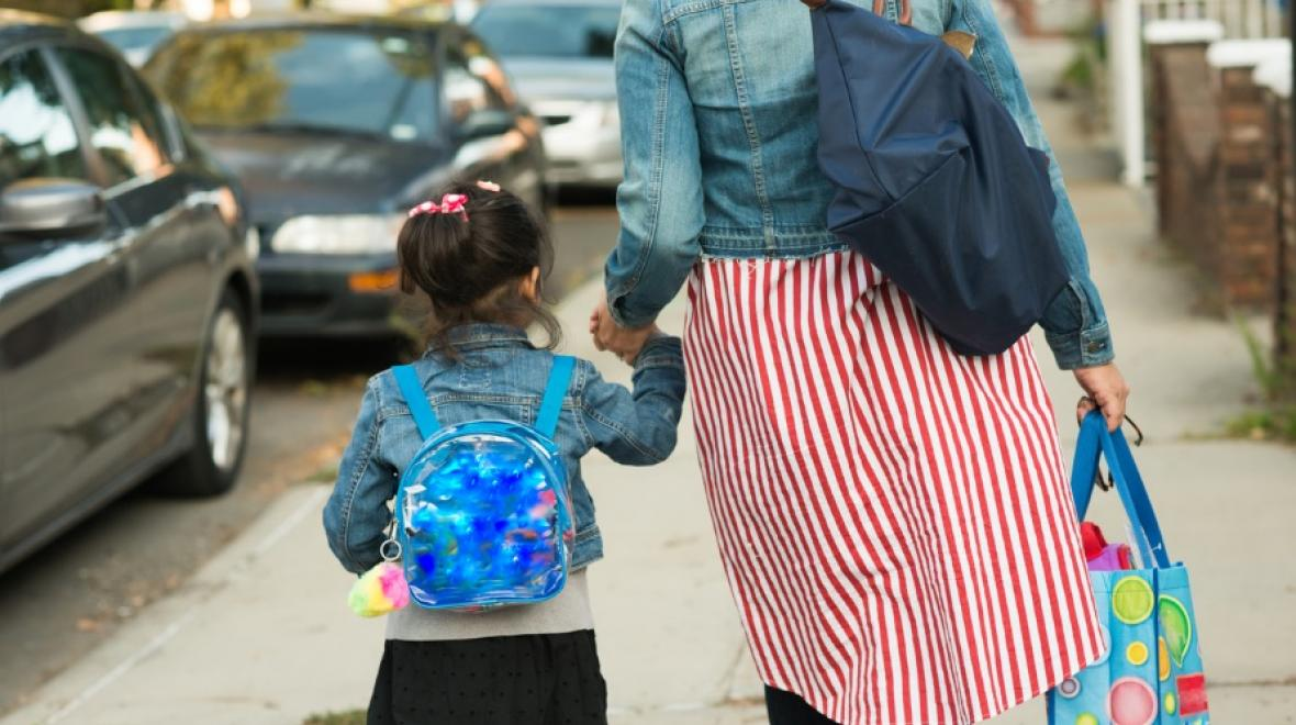 Mom with young kid on way to school