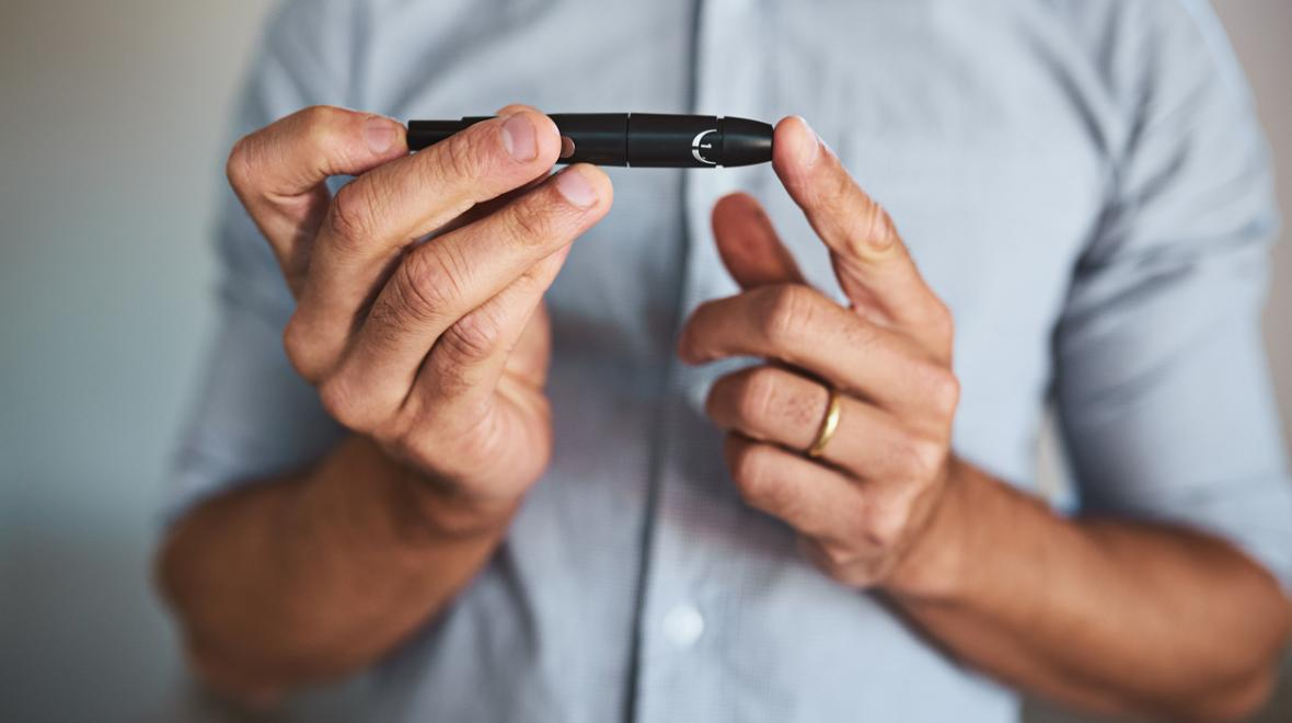 Man checking his blood sugar