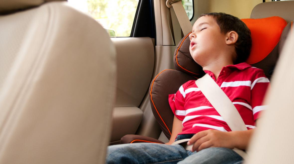 sleeping boy in carseat