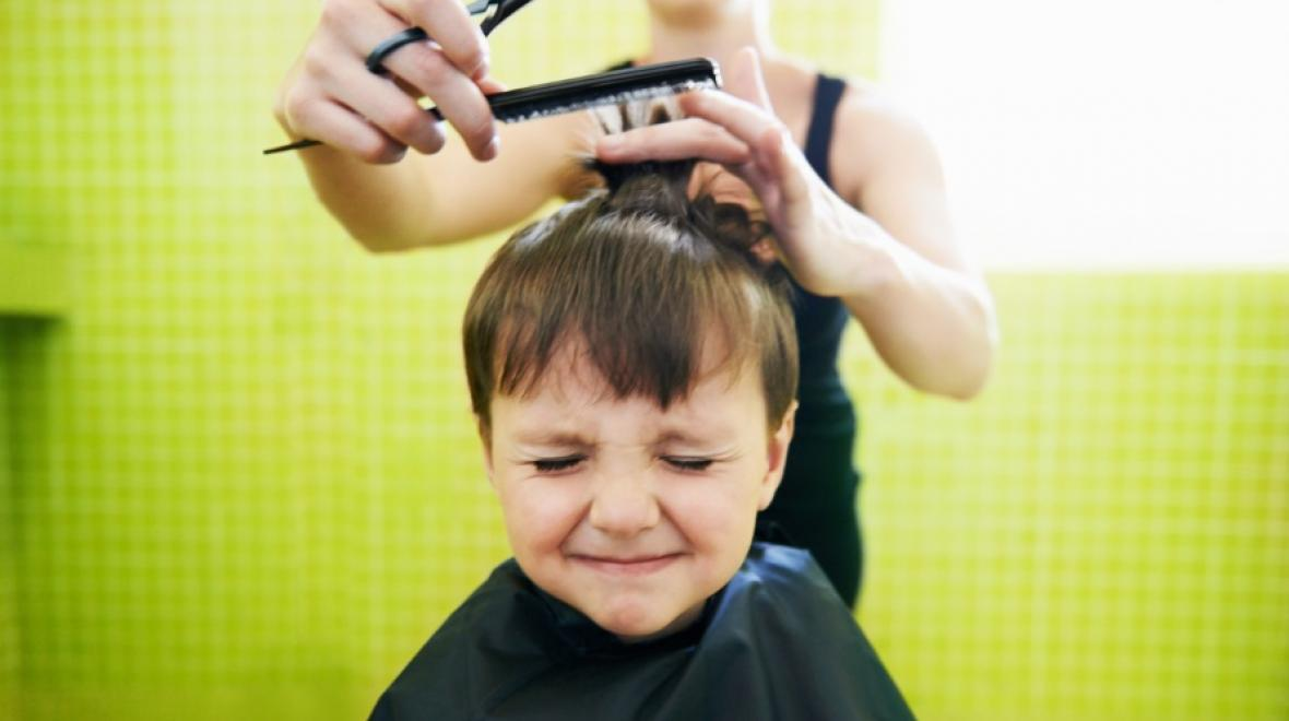 kid getting hair cut
