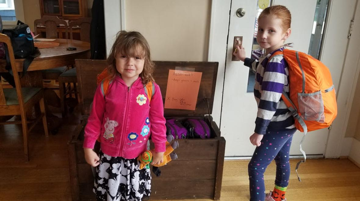Two young kids with their emergency preparedness backpacks