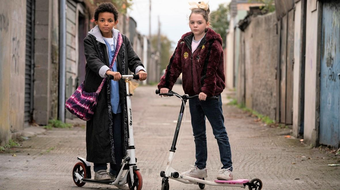 Two-girls-on-scooters-in-alley-film-short-still-The-Girl-at-the-end-of-the-garden-lift-off-shorts-program