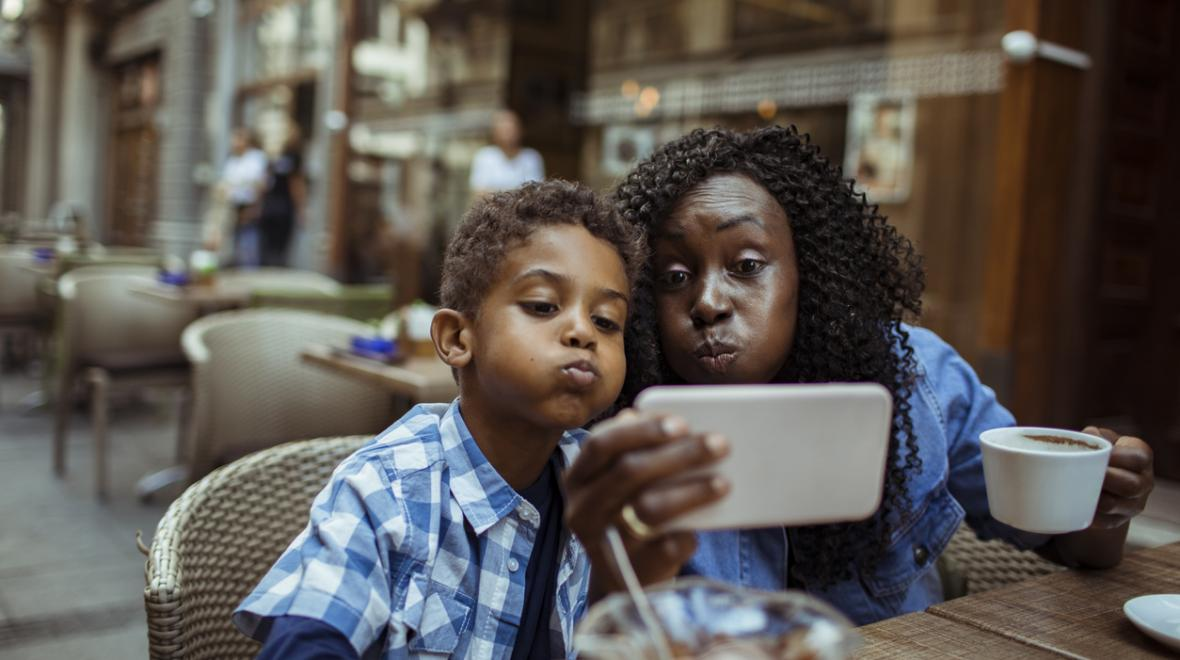 Mom-and-son-at-cafe-taking-selfie-parent-kid-date-night-ideas