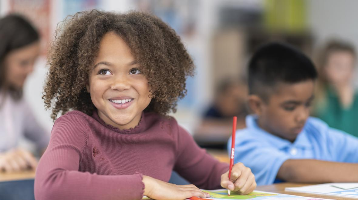 smart motivated girl looking confident in school class