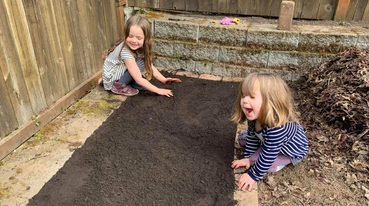 girls gardening in the backyard unexpected learning opportunities during coronavirus shut down