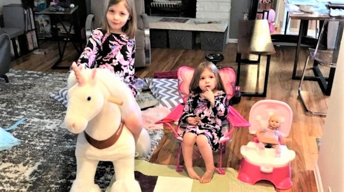 Girls-in-living-room-on-toy-horse-chair-doll-on-princess-potty