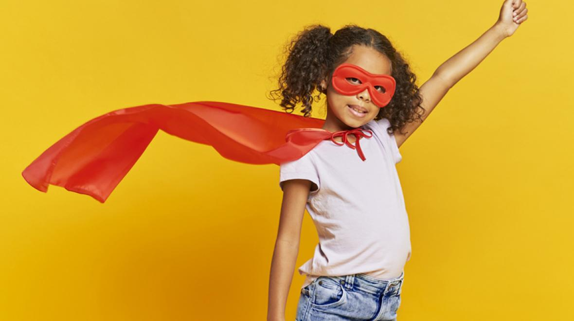 super girl wearing a cape on a yellow background