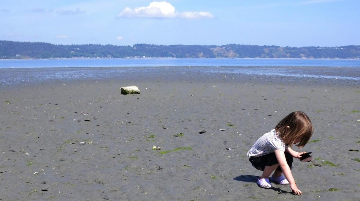 girl-playing-in-sand-Dash-Point-State-Park-Washington-near-Seattle
