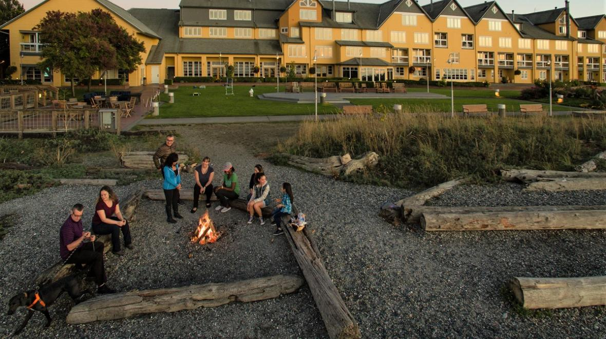 people sitting by a beach fire at Semiahmoo Resort in Blaine, Washington nearby travel destinations to book now