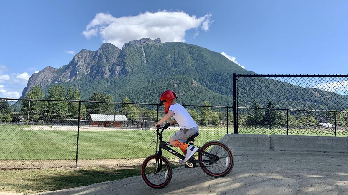 Boy riding a bike at Torguson Park pump track in North Bend, Wash.; pump tracks for Seattle-area kids and families